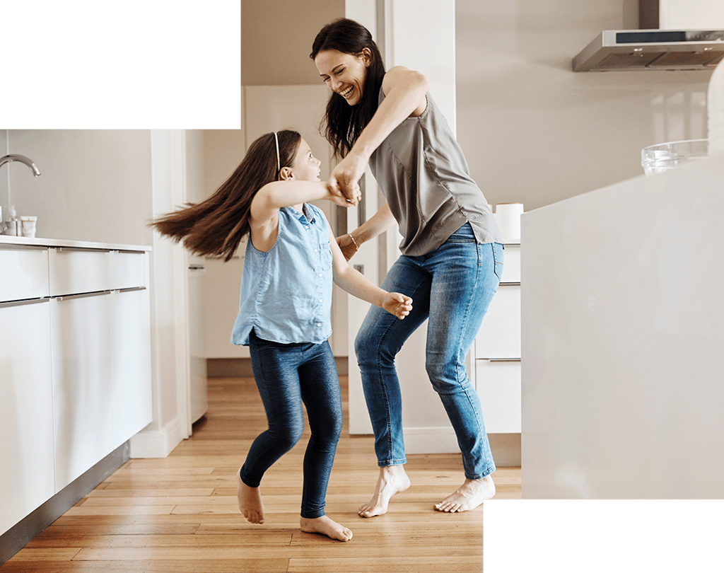 mother and daughter playing in the kitchen