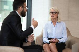 Mature businesswoman discussing project with business partner at meeting